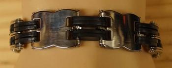"""Armband  """" Bloemmotief  """"   Zilverkleurig / zwart"""