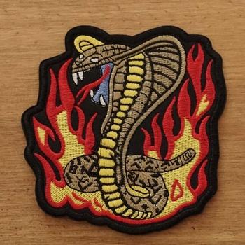 """Applicaties  """" Aanvallende cobra in vlammen """""""