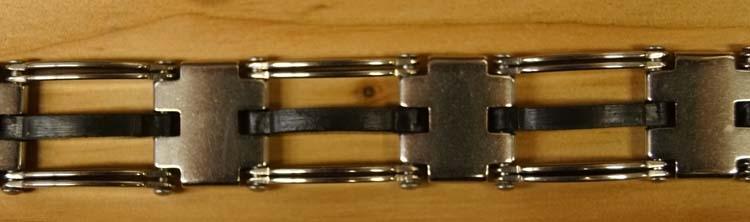 """Armband  """" Sierwerk bloem motief """"   Zilverkleurig / zwart"""