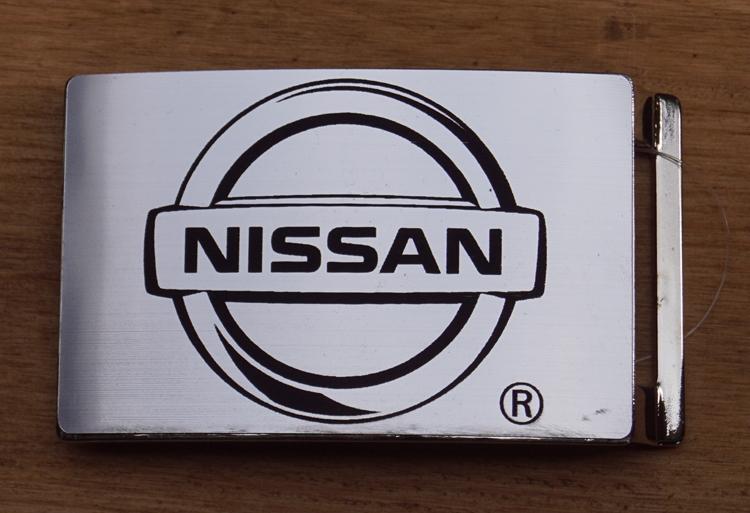 """Automerk  gesp  """"  Nissan """"   Zilverkleurig"""