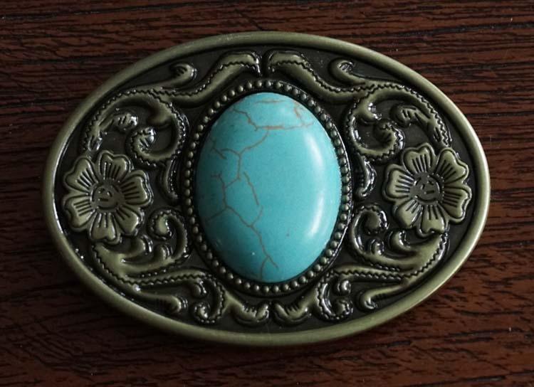 """Buckle  """" Bloemmotief met turquoise steen """" koper kleurig"""
