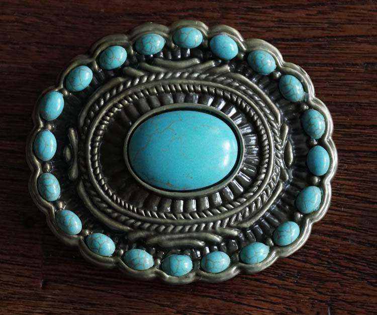 """Buckle  """" Sierwerk met grote en kleine turquoise stenen """""""