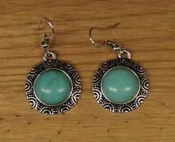 """Oorhangers   """"  Turquoise steen met zilveren sierrand """""""